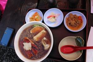 Ramen noodles topped with unagi and gyoza.