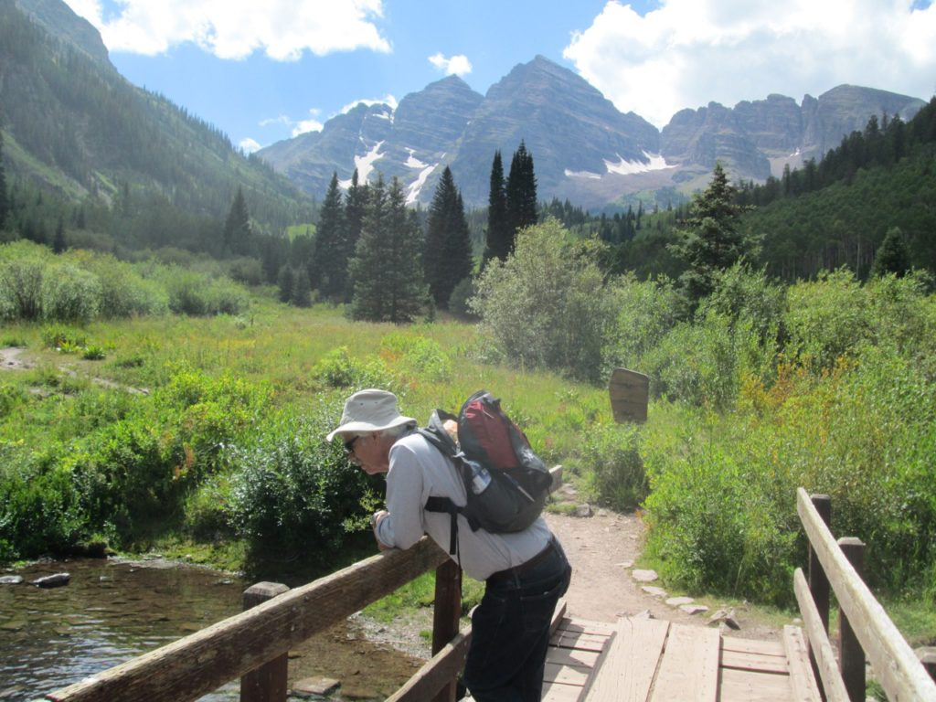 Contemplating a babbling brook in Maroon Bells